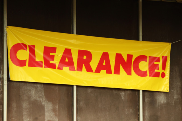 Clearance Sign by Jean Faucett (via Shutterstock).